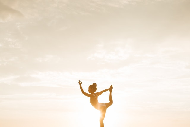 A woman in a standing Asana.