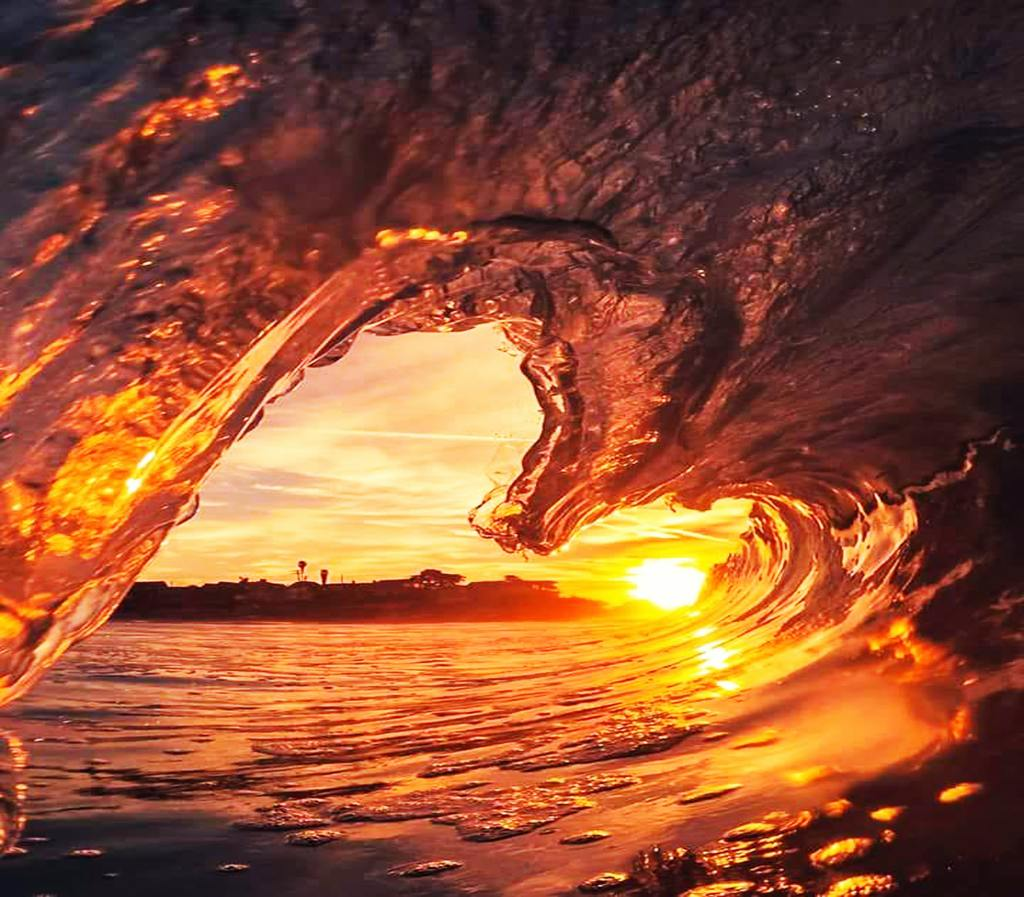 Frozen wave in the shape of a heart with the sunrise lighting it up.